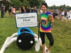 Staff member representing Community First in the Lakeview Summerfest boat race 2018